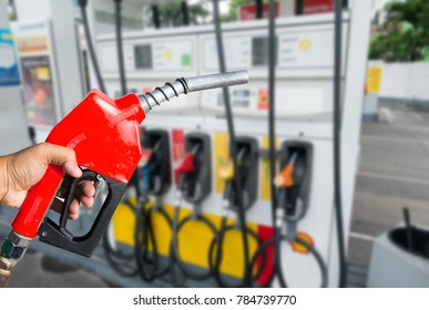 Fuel nozzle red on the floor of the dispenser