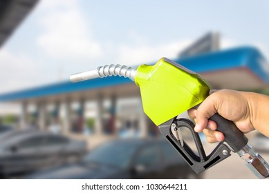 Fuel nozzle red on thebackground. Drive economy Travel investment