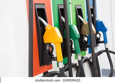 Fuel Pump, Gas Station, Gasoline.Colorful Petrol pump filling nozzles isolated on white background , Gas station in a service in warm sunset.Head fuel vehicle refueling facility in Asia