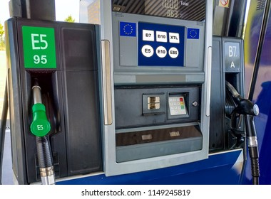 Fuel Pumps at the Petrol Station with new EU labels. Directive 2014 94 EU introduces the requirement of labeling new vehicles and fuel distributors at petrol stations by October 2018