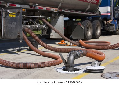 Fuel tanker diesel pumping fuel into filling station underground tank