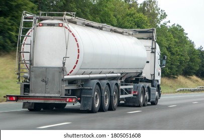 A fuel tanker traveling along a motorway in the United Kingdom