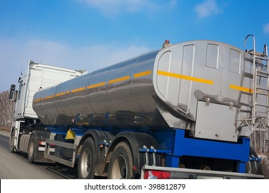 fuel truck with the chromeplated tank goes on the highway