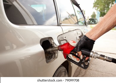 fueling car from old exhausted gas station