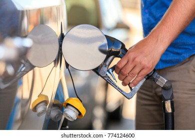Fueling a car at petrol station.