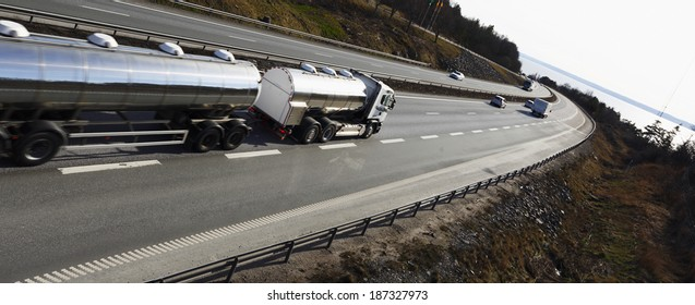 fuel-truck on the move, panoramic and elevated perspective, truck is slightly blurred