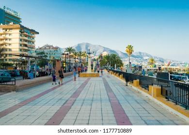 FUENGIROLA, SPAIN, AUGUST 28, 2018: Fuengirola seafront promenade on a summer day near Málaga, Andalusia, Spain