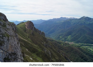 """Fuente De, Cantabria, Spain; 08/06/2017;  view from sumit station of cable car """"El Cable"""" back into the green Liebana Valley with valley Pido; Picos de Europa National Park"""