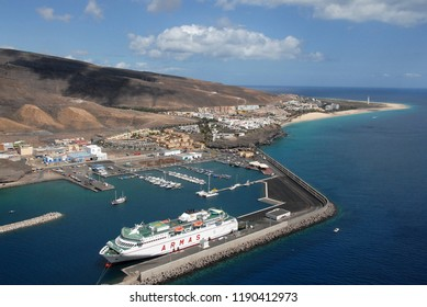 Fuerteventura, Canary islands - july 06, 2016: Aerial photograph of the port of Morro Jable on the south coast of the island, with a ferry docked inside