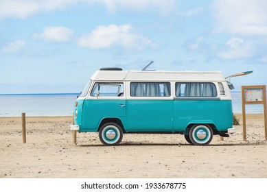 Fuerteventura, Canary Islands - June 23 2018. Classic Green and white Camper VW Van parked on beach in Fuertev