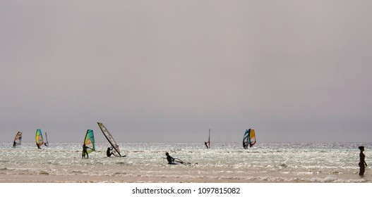 FUERTEVENTURA, CANARY ISLANDS, SPAIN - AUGUST 27, 2017: people make windsurf to Sotavento beach, Risco Del Paso, Fuerteventura, Canary Islands, Spain