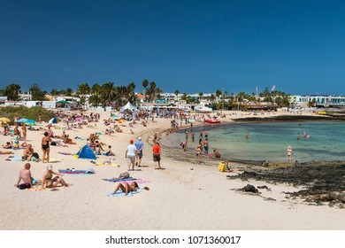 FUERTEVENTURA - SEPTEMBER 20: Tourists enjoying the day at a Corralejo City beach in Fuerteventura, Spain on September 20, 2015