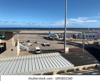 Fuerteventura, Spain - December 31, 2020. View of the airport and aircraft connected with jet bridge ready for boarding.
