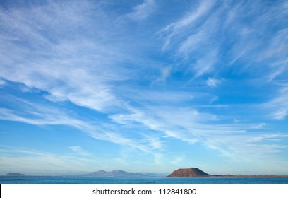 Fuerteventura, view towards Isla de Lobos and Lanzarote, natural background of predominantly sky