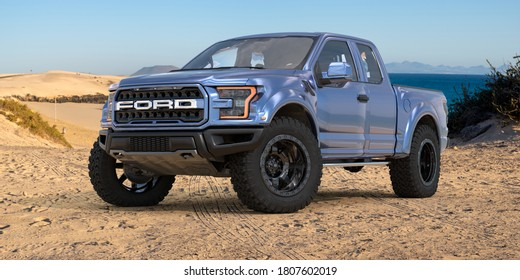 Fuerteventura,Spain-January 2020:Ford F-150 Raptor - Most Extreme Production Truck On The Planet standing on a sand dune by the ocean