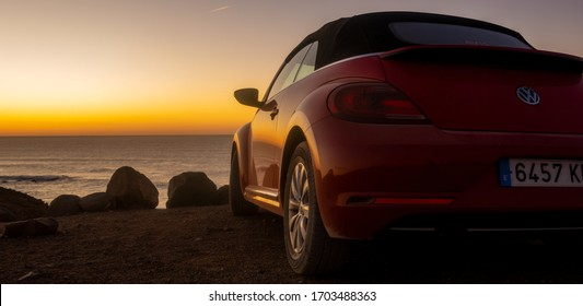 Fuerteventura,Spain-January 2020:Volkswagen New Beetle cabrio on a cliff above the ocean