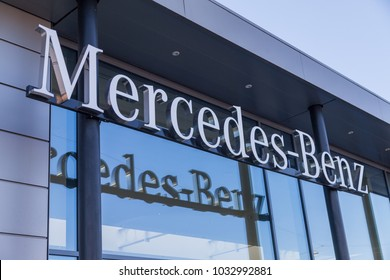 FUERTH / GERMANY - FEBRUARY 25, 2018: Mercedes-Benz logo hangs on a car dealer building. Mercedes-Benz is a global automobile marque and a division of the German company Daimler AG.