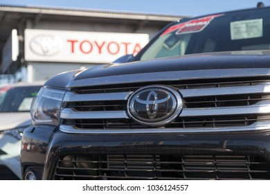 FUERTH / GERMANY - FEBRUARY 25, 2018: Toyota logo on a car. Toyota Motor Corporation is a Japanese multinational automotive manufacturer headquartered in Toyota, Aichi, Japan.