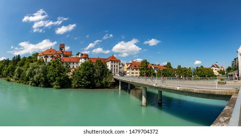Fuessen, Germany - August 4, 2019: High Palace and Saint Mang monastery in Fuessen on river Lech, Germany.
