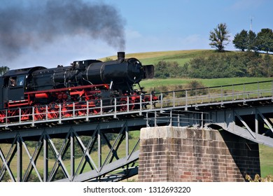 """Fuetzen, Germany - September 2012: Historic steam train """"sauschwaenzlebahn"""" (pig tail rail) line in the Black Forest, Germany, now a tourist attraction"""