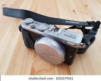 Fufjifilm X70, retro style look camera on a table. Fixed lens digital photo camera. 23 March 2018, Bucharest ,Romania.