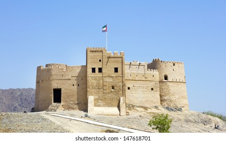 Fujairah Fort against deep blue sky, built in 1670, considered the oldest fort in the UAE , City of Fujairah, Fujairah Emirate, United Arab Emirates