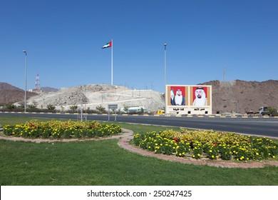 FUJAIRAH, UAE - DEC 14: Roundabout in Fujairah with national flag and portraits of the rulers. December 14, 2014 in Fujairah, UAE