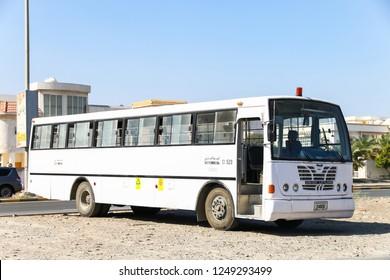 Fujairah, UAE - November 18, 2018: White bus Ashok Leyland in the city street.
