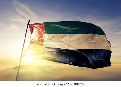 Fujairah and United Arab Emirates flag textile cloth fabric waving on the top