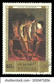 Fujeira - circa 1971: Stamp printed by Fujeira, Color edition on Art, shows Painting Saint Joseph Menuisier by De La Tour, circa 1971
