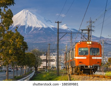 FUJI CITY, JAPAN-APRIL 6: Japan Rail train pulling into Fuji Station, April 6, 2014 in Fuji City. Train system is the most effective transportation in Japan with over 10 millions people using everyday