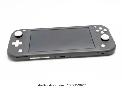 Fuji City, Shizuoka Ken, Japan - May 23, 2021: Nintendo Switch Lite Console Gray. Isolated on white background. Front view.