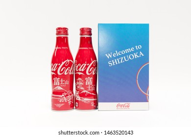 """FUJI CITY, SHIZUOKA PREFECTURE, JAPAN - January 30, 2019: Souvenir - Coca-Cola can bottle in gift packaging with Mount Fuji illustration. Written on the packaging """"Welcome to Shizuoka""""."""