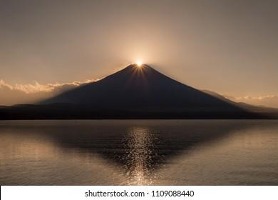 Fuji Diamond. Fuji diamond at Lake Yamanakako in winter season. Diamond Fuji is the name given to the view of the setting sun meeting the summit of Mt. Fuji.
