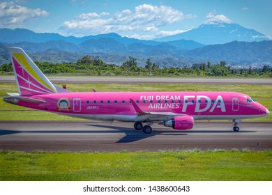 Fuji Dream Airlines JA03FJ with Mount Fuji as a background, before taking off from Mt. Fuji Shizuoka Airport, Shizuoka, Japan, June 16th 2019