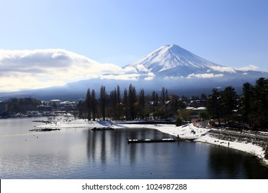 Fuji mountain in the autumn season with beautiful reflection of surface water.