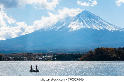 fuji mountain with fishing boat and shimmer of sunlight reflecion.