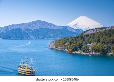 FUJI MOUNTAIN, JAPAN-APRIL 5, View to Fuji Mountain and Ashi Lake at Hakone region on April 5, 2014. Pirate ship does round trip over lake. Ship is very popular attraction for local tourist.