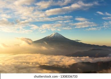 Fuji mountain and the mist over Lake Kawaguchiko at beautiful sunrise , Yamanashi, Japan, Mount Fuji or Fujisan located on Honshu Island, is the highest mountain in Japan