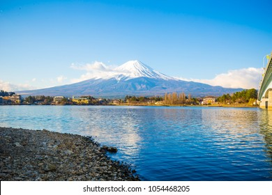 Fuji mountain outstanding along Kawaguchigo lake beach view with snow blue sky morning, Yamanashi Japan