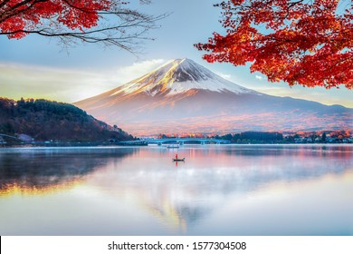 Fuji Mountain Reflection and Red Maple Leaves with Morning Mist in Autumn, Kawaguchiko Lake, Japan