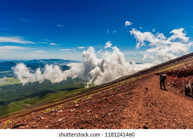 Fuji Mountain, Yamanashi, Japan – 8/26/2018 : Tourist descending Fuji Mountain on yoshida trail.