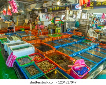 Fuji, Taiwan - October 03, 2016: Various fresh fish, shells and other sea creatures in containers on a stall  on a  Fuji fish market