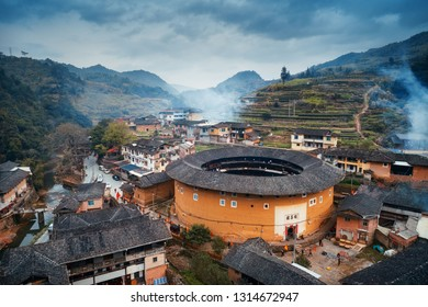 FUJIAN, CHINA – MARCH 2, 2018: Aerial view of small rural village with Tulou. Tulou is the unique traditional rural dwelling of Hakka.