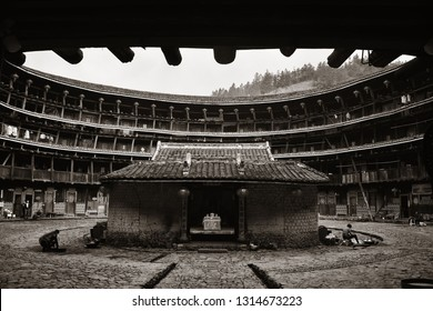 FUJIAN, CHINA – MARCH 2, 2018: A wide angle view of Tulou courtyard. Tulou is the unique traditional rural dwelling of Hakka.