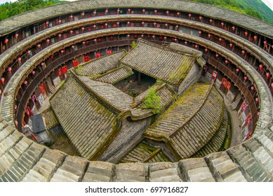 fujian tulou (hakka roundhouse). The Red paper with chinese words are couplets with lucky poem