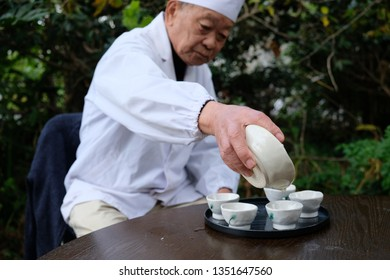 Fujieda/Japan_18 feb 2019: Tea master making Gyokuro tea at the park. Gyokuro tea is considered the most precious and most noble of all teas.