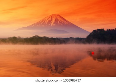 Fujisan or Fuji mountain landscape with relfection from Lake Shoji or Shojiko at dawn with twilgiht sky and mist in early morning, Japan