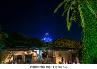 FUJISAWA, KANAGAWA / JAPAN - AUGUST 17 2019 : Enoshima observation lighthouse illuminated in blue. It is popular as a night date spot.