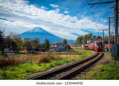 Fujiyoshida, Japan, November 01, 2018:  Mt. Fuji with train and rice field at Fujiyoshida, Japan.